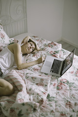 young woman relax with laptop on the bed