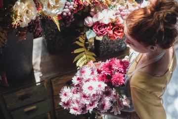 Ginger-Haired Woman Holding a Flower Bouquet