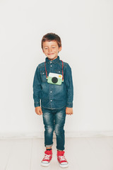 Portrait of funny little boy with diy camera