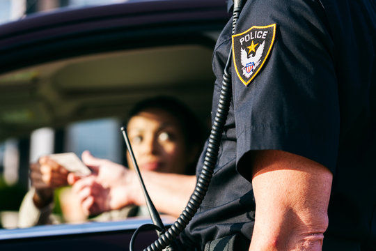 Police Woman Pulled Over Hands License To Officer