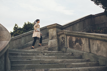 Businesswoman Going Up the Stairs