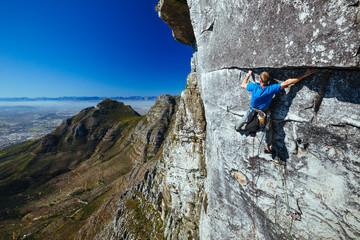 Rock climber on a sheer cliff face