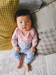 Newborn baby looking at camera