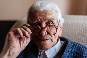 Senior man sitting at home