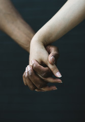 Mixed-race couple holding hands