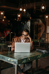 Stylish man working in a restaurant