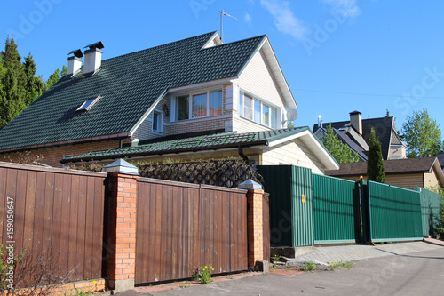Modern brick countryside houses with a fence. Eastern Europe, Russia ...