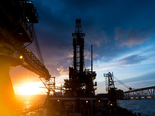 Wall Mural - Derrick of Tender Assited Drilling Oil Rig (Barge Oil Rig) on The Production Platform During Sunrise