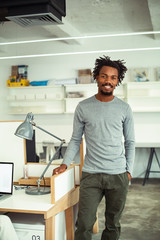 Young African Businessman Standing by His Desk
