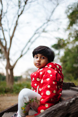 Child looking at the camera in a pensive mood