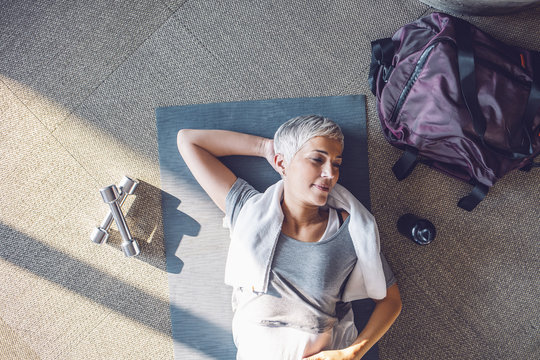 Senior Woman Lying on the Floor after the Workout