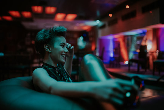 Young attractive woman smiling at the club at night