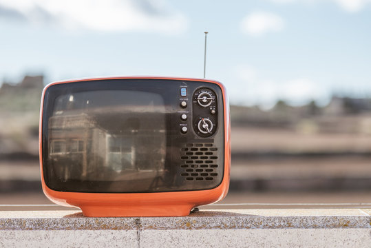 Vintage television with a sky background