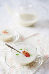 Chilled fennel soup served with tomato granita and micro herb garnish