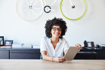 Portrait of millennial businesswoman in office