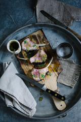 Minted lamb chops on a cutting board