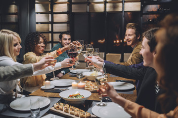 Group of Friends Making a Toast at a Dinner Party
