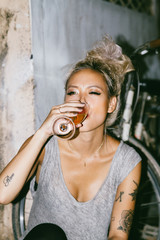 Young Asian fashion model drinks champagne