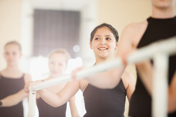 Ballet Girls Lined Up at Ballet Barre