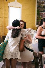 Shower Friends Embrace At Bridal Party