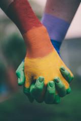 Hands painted in Gay pride rainbow
