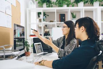 Graphic designers having discussion at work