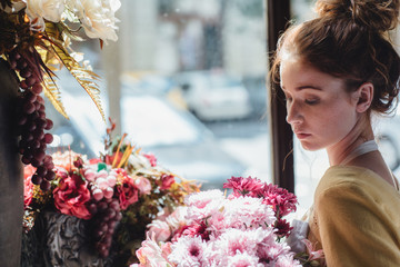 Ginger-Haired Woman Holding a Flower Bouquet in a Flower Shop