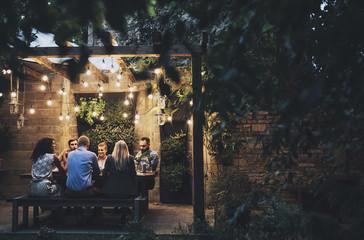 Friends Having Dinner in The Yard