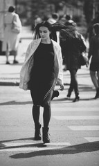 beautiful woman  crossing the street