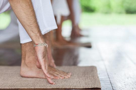 Close-up of a man practicing yoga
