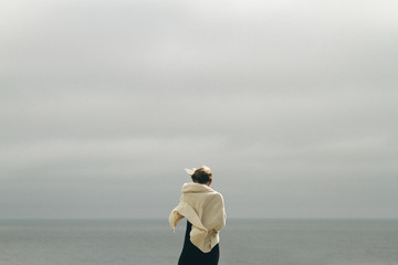 Young woman looking out at ocean