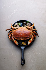 Cooked brown crab in a skillet From above
