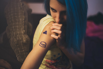 Young Woman with a Tattoo on her Arm