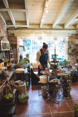 Small artisan business owner in shop