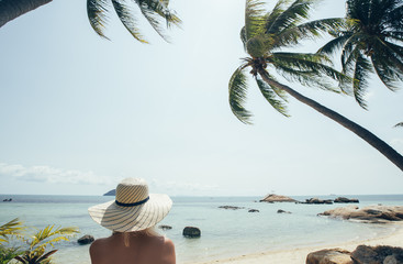 Woman With a Hat at the Beach