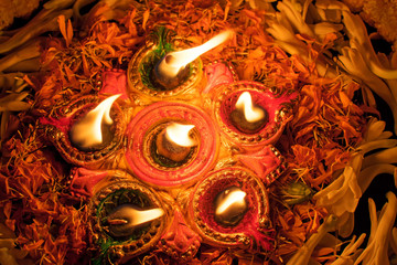 Deepabali - colourful candles are lit in darkness