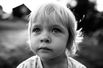 Natural black and white portrait of a cute toddler girl