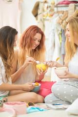 Teenage Girls Eating Fruit Salad Together