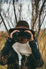 woman exploring  with binoculars