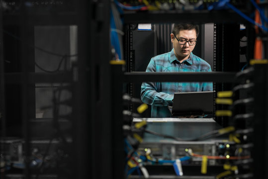 Young engineer working in datacenter