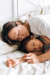 Young mother and her daughter sleeping