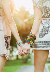 Friendship - two girls enjoying summer day and holding hands