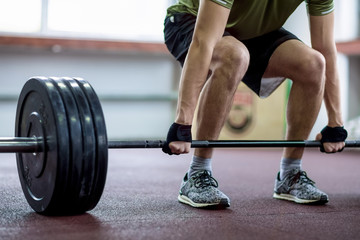 Man Holding a Weight in the Gym