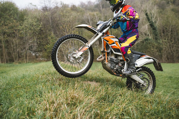 Motocross rider in the forest