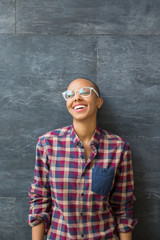 Portrait of a smiling african american woman with reading glasses