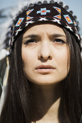 closeup of young woman in indian headdress