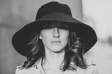 Pretty girl big black hat portrait