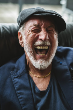 Happy senior man laughing
