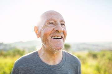Portrait of a smiling senior man in the mountain