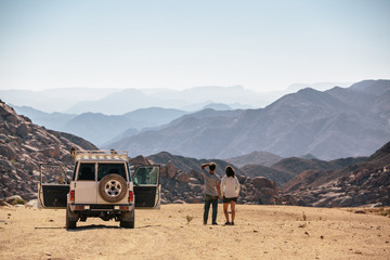 Outdoorsy couple on a roadtrip in the desert